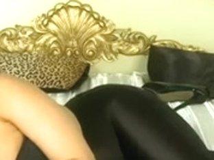 Brunette Hair in her shiny leggings