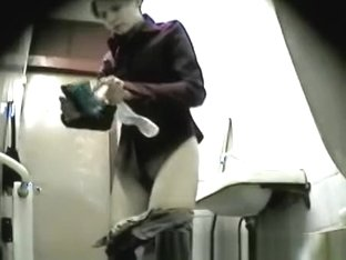 Girl Changes Pad In Public Toilet