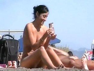 Pretty nude girl at a beach