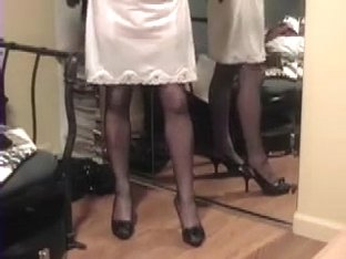 lifts skirt to show slip and stockings