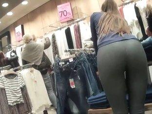 Sexy store clerk in tight leggings