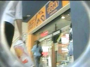 Shopping mall candid upskirt shots of unsuspecting girls browsing
