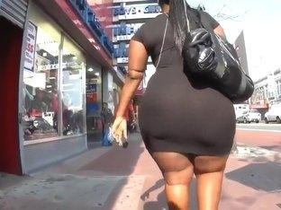 Ebony BBW with a huge booty walks down the street