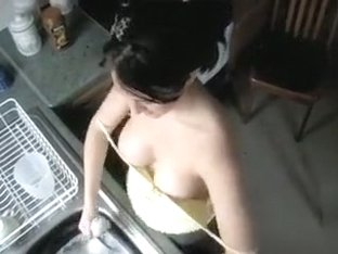 Big breasts brunette does the dishes topless
