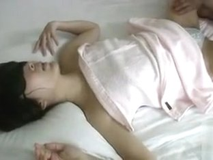 Blindfolded Asian cutie receives an arousing massage