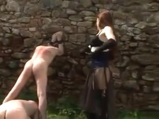 Mistress Whipping two slaves outdoors