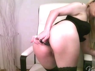 Busty blonde plays with a dildo up her butt