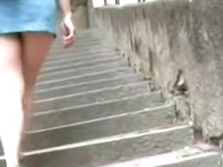 Wide ass girl towing her load up the stairs in this voyeur video