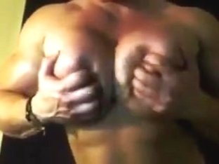 muscle woman shows her big boobs