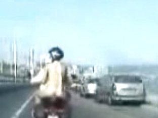 Smoking hot chick gets completely naked and rides a motorcycle