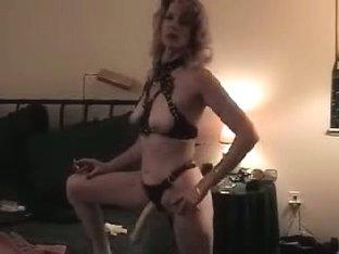 Girl posing in strapon