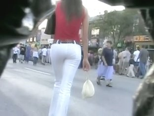 Super hot girl followed by a spy cam through a crowd