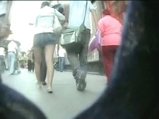 Voeyur cam slowly closing in on a girl walking down the street