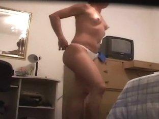 Dancing woman gets dressed