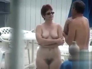 Redhead mature whooty talks naked to her man while a couple has fun