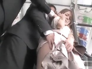 Japanese cutie in skirt and pantyhose groped on train
