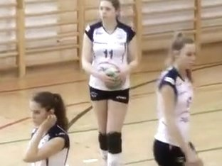 Arousing girls play a bit of volleyball