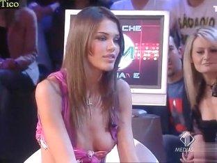Skimpy dress cleavage tease on TV talk show