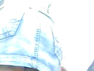 Street upskirt video with sexy babe in jeans short skirt