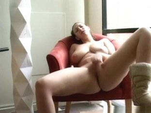 Busty girl wildly rubs her shaved pussy on a chair