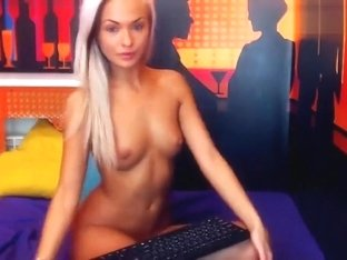 Beautiful blonde MargoX undressing in front of camera