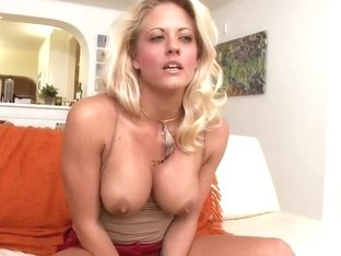 Tattooed MILF Holly Heart shows us her huge rack
