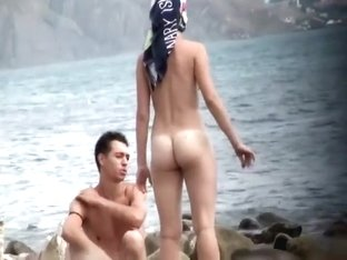 Nude girl spied as she picks up seashells