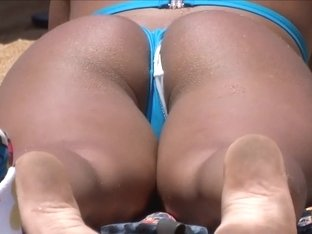 Tanned bootylicious chick wears a really flimsy bikini bottom