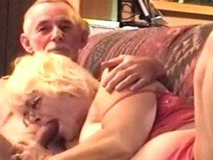 Grandma sucks grandpa's cock, while he watches tv.
