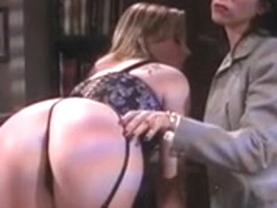Floozy spanked on desk with paddle