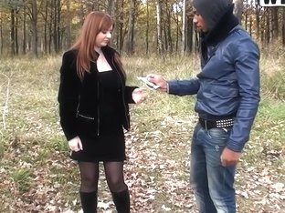 Busty redhead girl gives head to two guys in a park