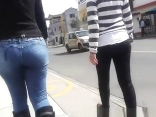 Teens walking in the street have nice asses