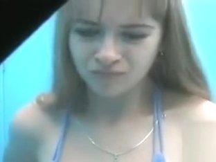 Cute teen putting on a blue bikini