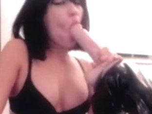 Sucking on a toy in front of webcam