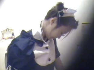 Kinky Asian maid spotted on a hidden camera fingering her twat