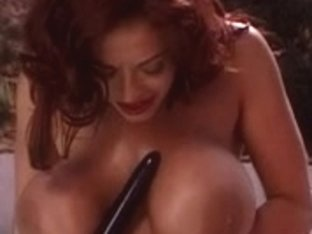 Breasty ebon floozy shows her biggest jugs and plays with marital-device