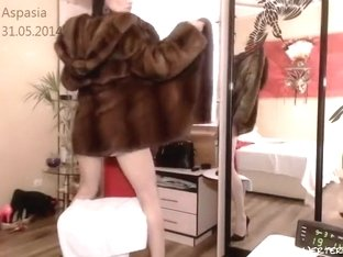 Aspasia was wearing a fur coat over his naked body