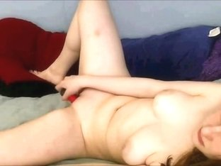 Redhead plays for the web camera