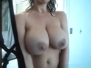 Hot big boobed brunette showers, teases and masturbates.