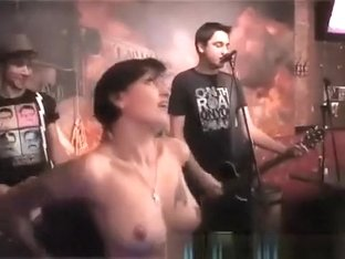 Drunk girl topless in concert