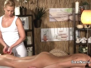 Masseuse stretching and fingering busty babe