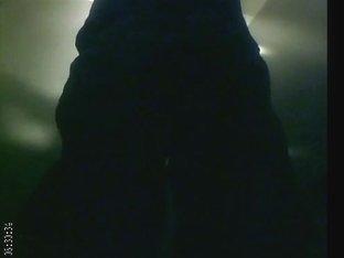 Long-legged beauty filmed in a dark changing room
