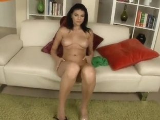 Gorgeous Dasi West is sitting on couch in black panties and sliding them to the side to show off h.