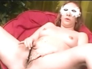 Masked babe masturbates her wet mature cunt and asshole
