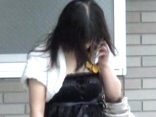 Cute Asian teen on her phone got a good boob sharking.