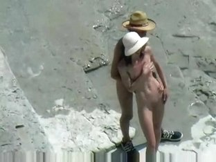 Bare beachgoers caught fucking on cam