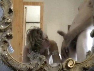 Blonde chick on knees gets facialed porn