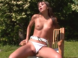 Shaved babe is fingering wet pussy outdoor