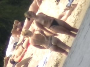 Mature women with big butts taking sunbaths on the beach