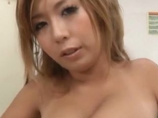 Lovely Asian milf with long blonde hair tit fucks her guy